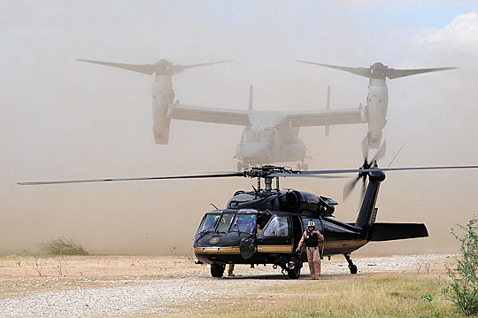 U.S. helicopters land outside the U.S. Embassy in Haiti.