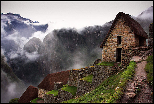 Storage Huts and Andean mountains in dense fogs