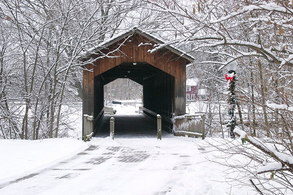 quiet winter bridge in snowfall