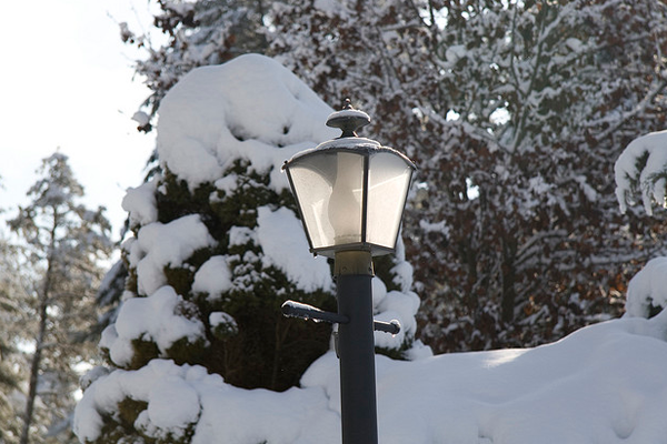frozen snow covered lamp post object dark