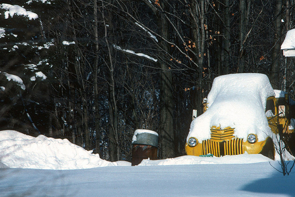 yellow truck in the snow blanket