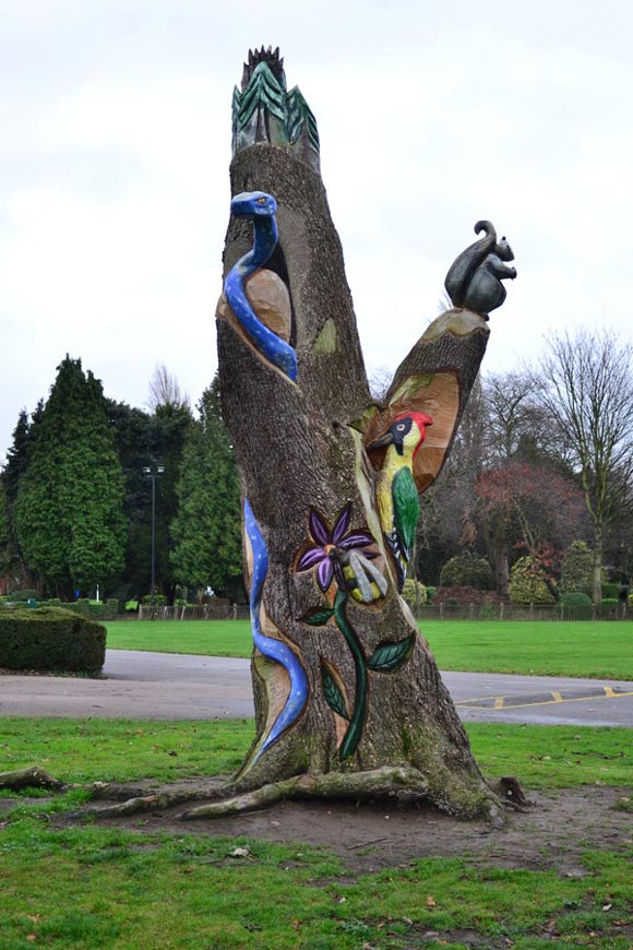colorful animals carved in tree