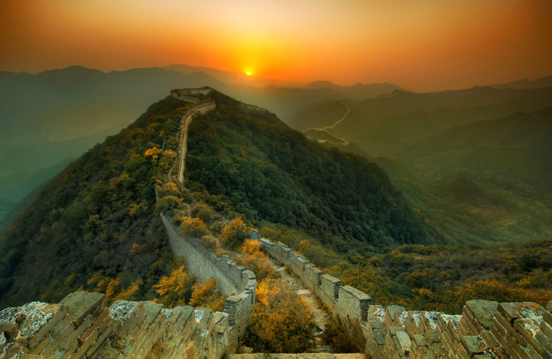 abandoned great wall of china nature overtaking growing over