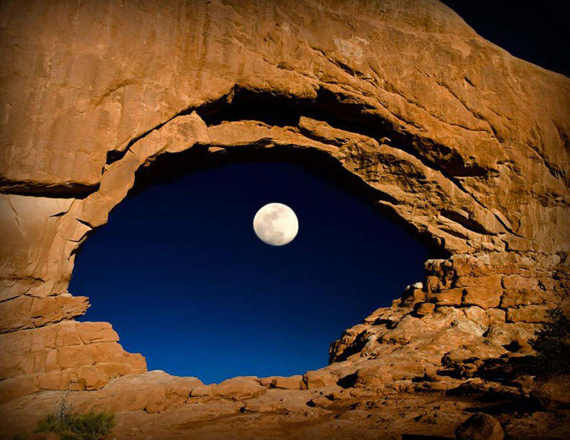 the moon through north window arches national park utah united states