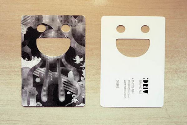 Smiley or emoticon in a die-cut business card