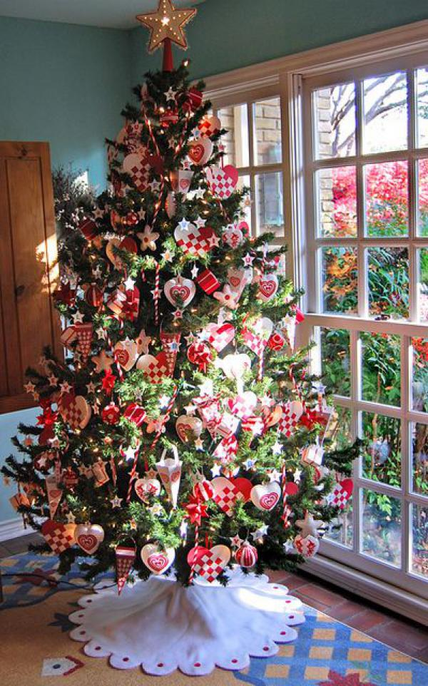 lovely Christmas tree decoed with red themed ornaments checked=