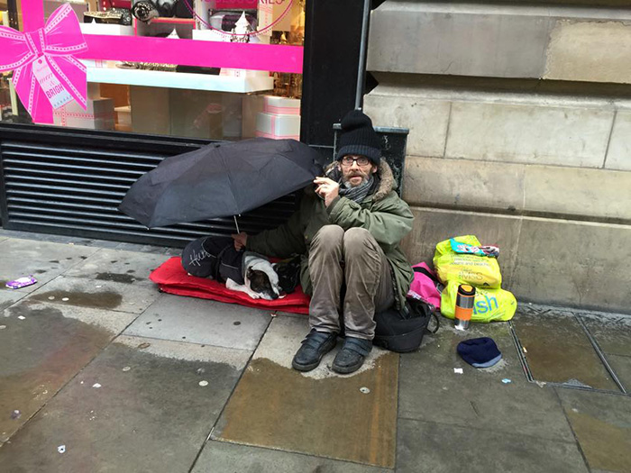 Dog Sleeps Under His Homeless Owner's Umbrella